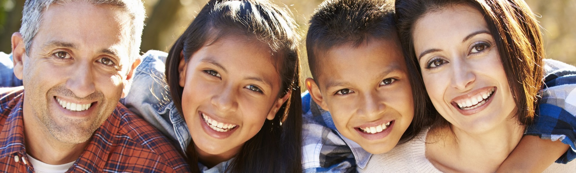 A happy family portrays the concept of who we serve at Discovery Smiles Dentistry.